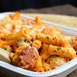 white baking dish filled with chicken meatball baked ziti on a wooden table