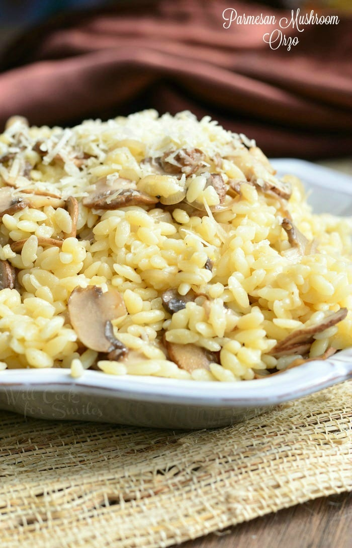 Parmesan Mushroom Orzo in a serving bowl on a wood table with a table cloth