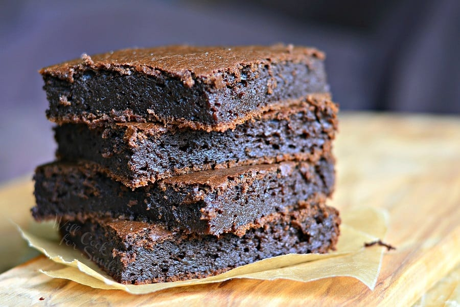Pumpkin Brownies stacked up on parchment paper