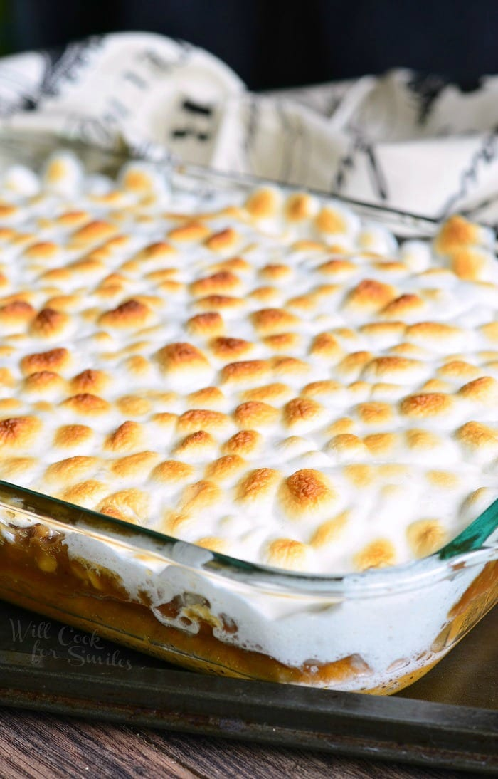 Sweet Potato Casserole with melted marshmallows on top Cake in a glass baking dish