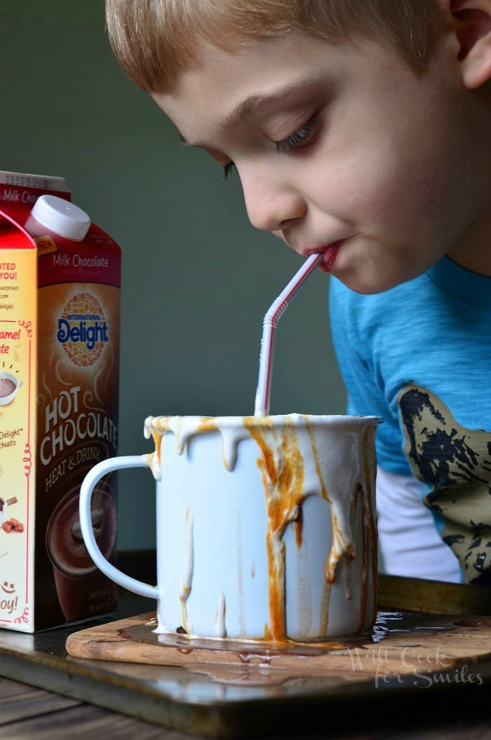 Caramel Marshmallow my son drinking Hot Chocolate with a white mug with marshmallow and caramel on top