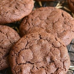 2 chocolate chocolate chip gingersnap cookies on a cooling rack