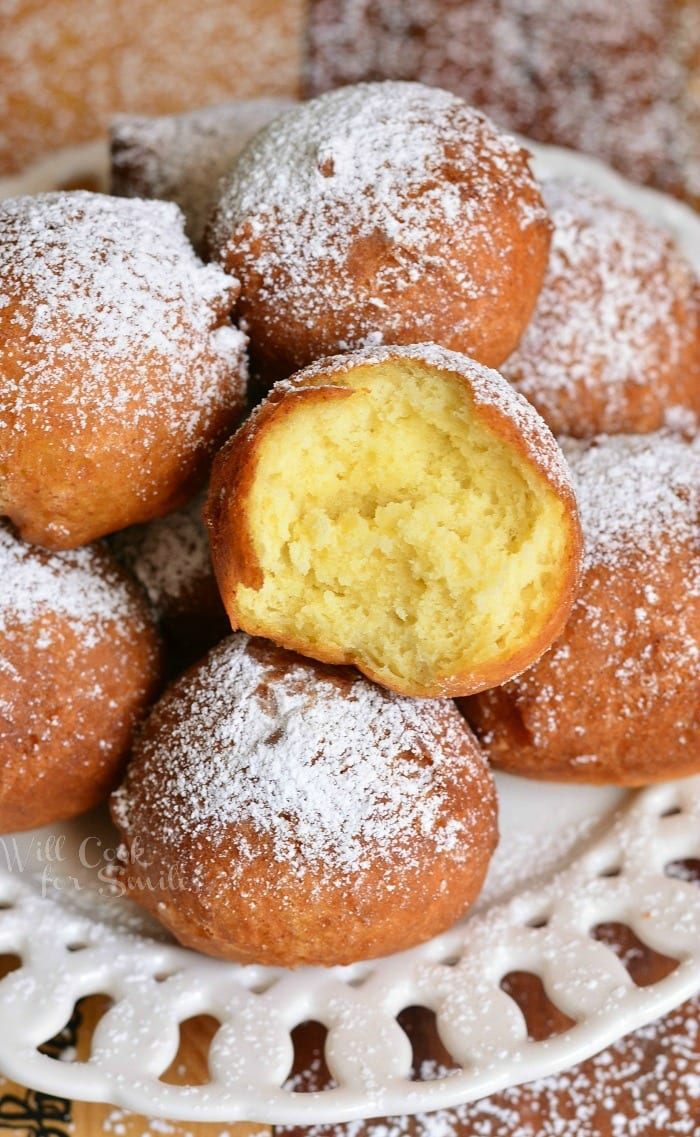Easy Ricotta Doughnuts with powdered sugar on top on a white plate