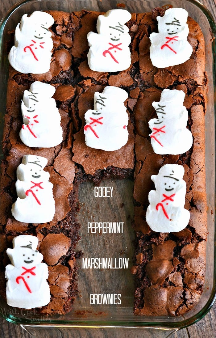 Brownies with snowman marshmallows on top in a glass baking dish
