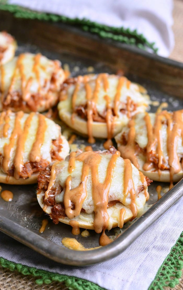 BBQ Chicken Bagel Bites. bagel bites topped with BBQ smoked chicken, Monterrey Jack and Asiago cheeses, and topped with BBQ Ranch dressing. #appetizer #snack #bbqchicken #chicken #bagel #partyfood