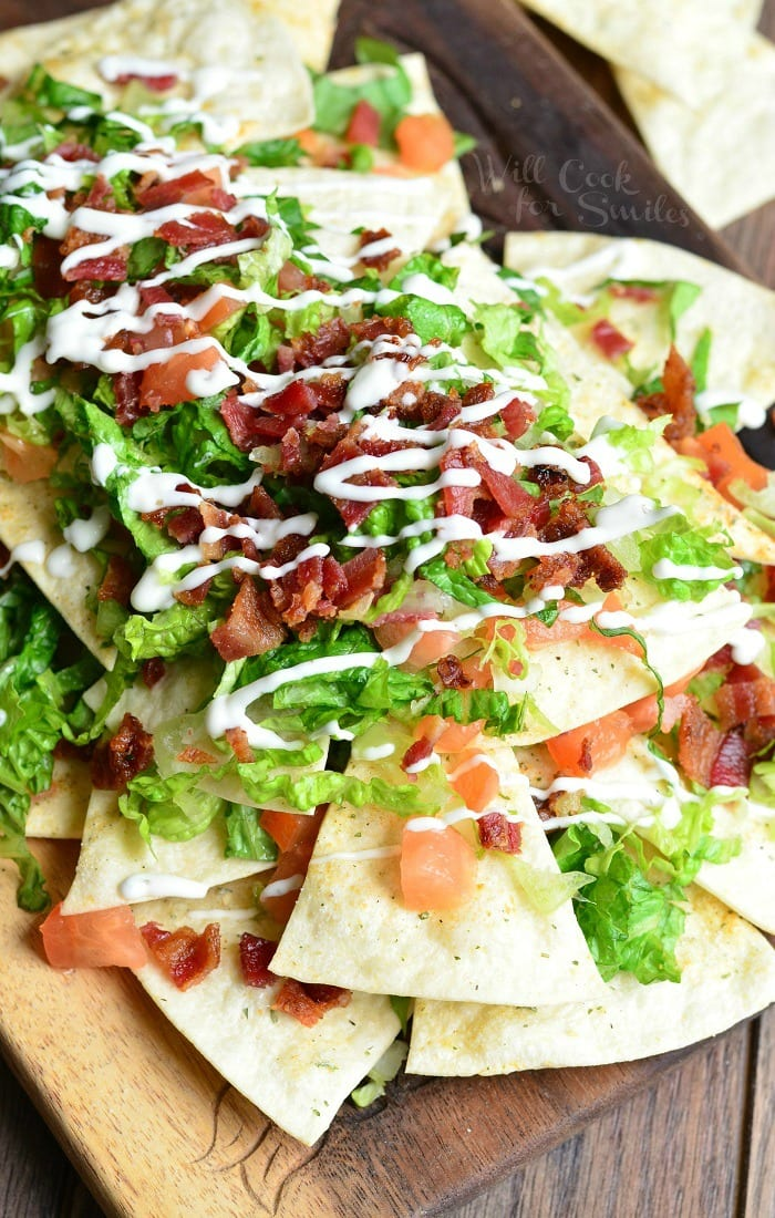 BLT Nachos with Homemade Baked Cool Ranch Tortilla Chips on a cutting board