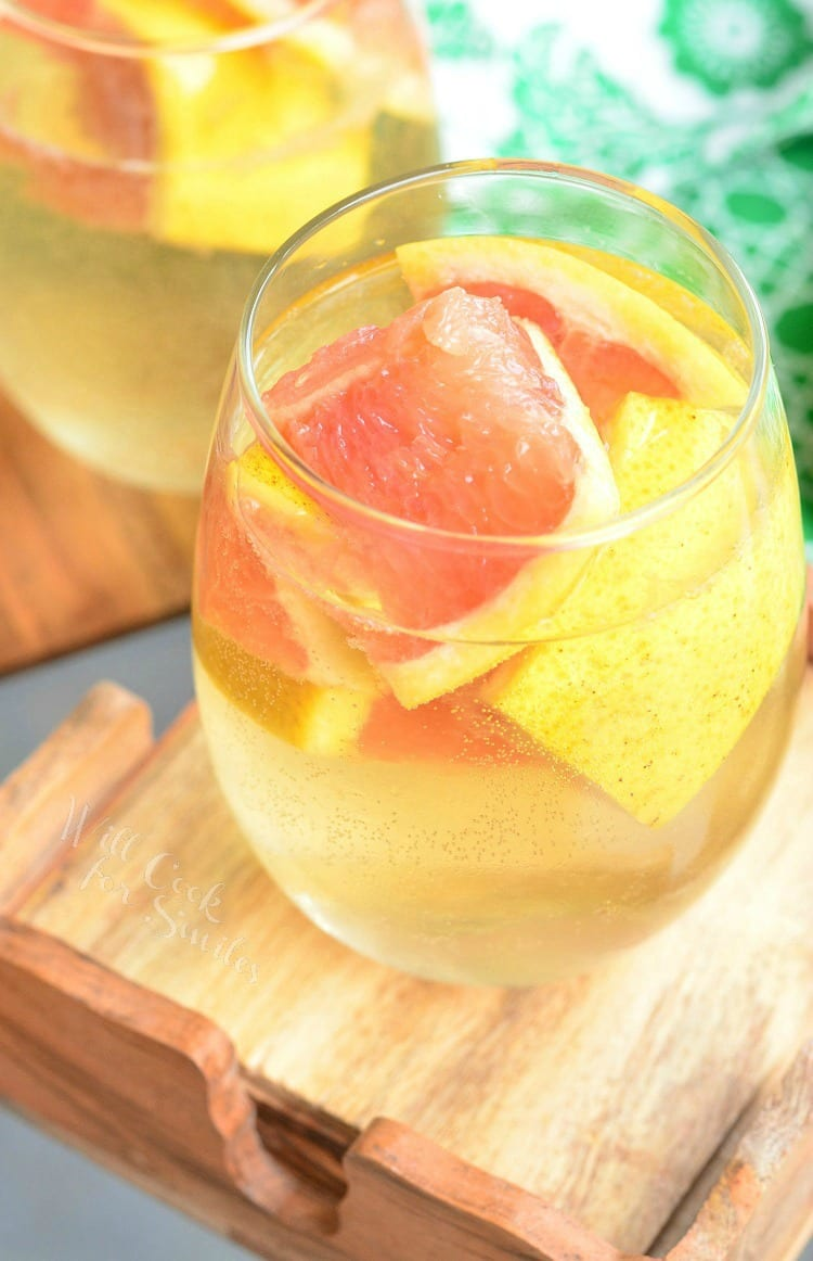 Fresh Grapefruit Sangria in a stemless wine glass with grapefruit in it
