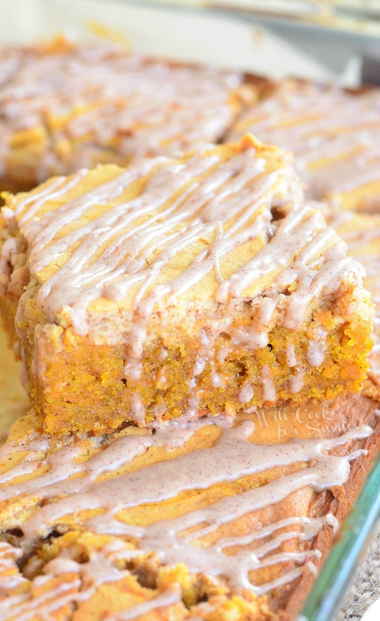 Spiced Cheesecake Swirled Carrot Cake. Delicious Spiced Carrot Cake swirled with Cinnamon Cheesecake and topped with Cinnamon Glaze.