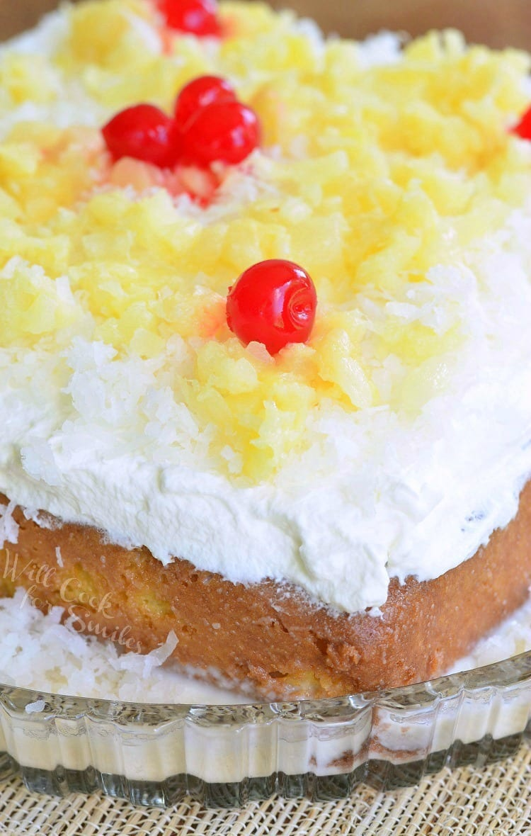Tres Leches Cake with white coconut frosting, pineapple and  cherries on top
