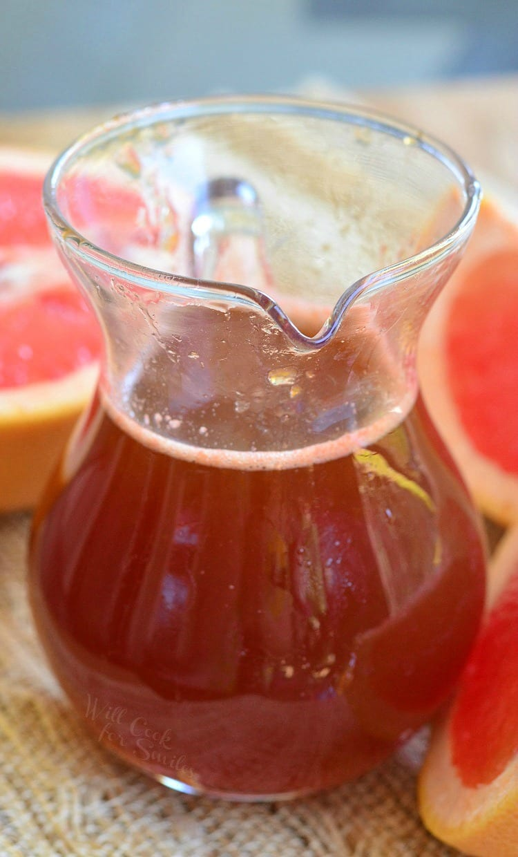 Homemade Grapefruit Syrup in a glass container