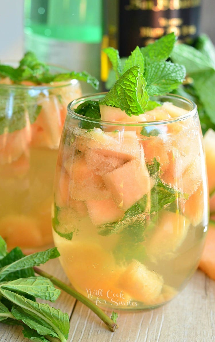 Melon Mint Wine Spritzer. Fresh fruit, mint leaves, touch of sweetness, and white wine makes this sparkling cocktail perfect for hot weather.