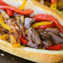 Fajita philly steak sandwich on a baking sheet tray as viewed close up and from above