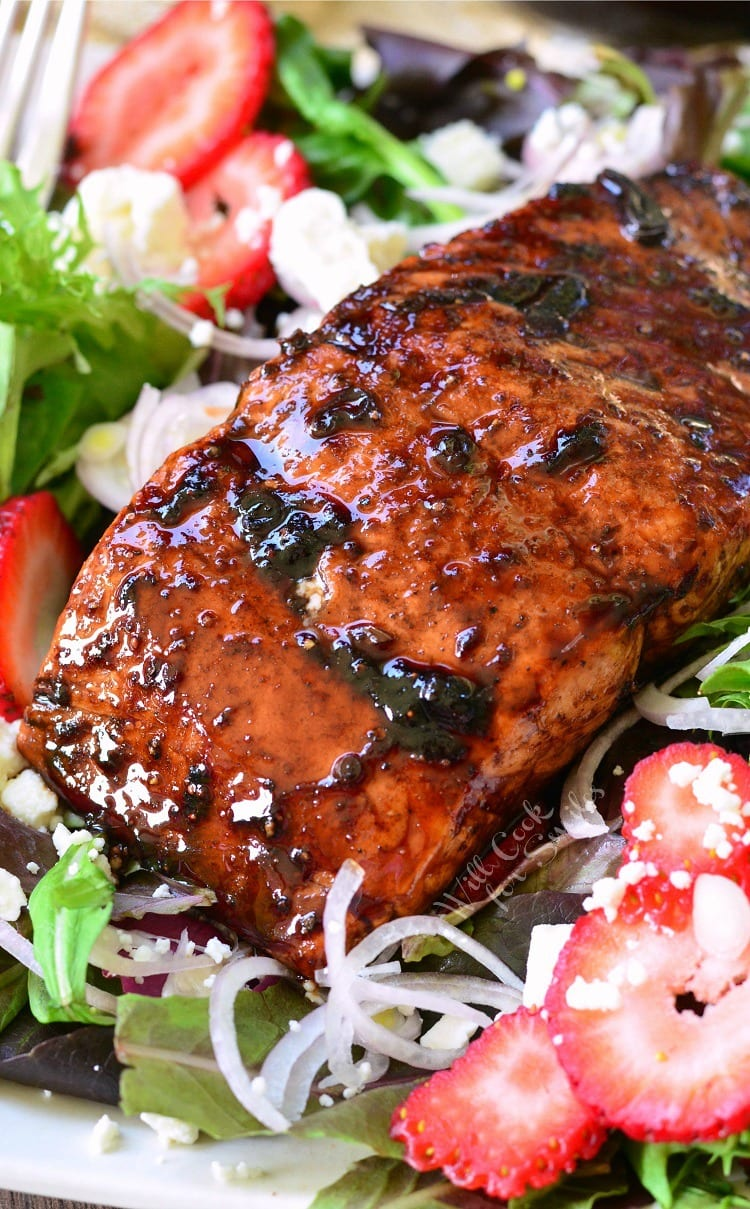 top view photo of Strawberry Balsamic salad with Glazed Salmon over the top of it