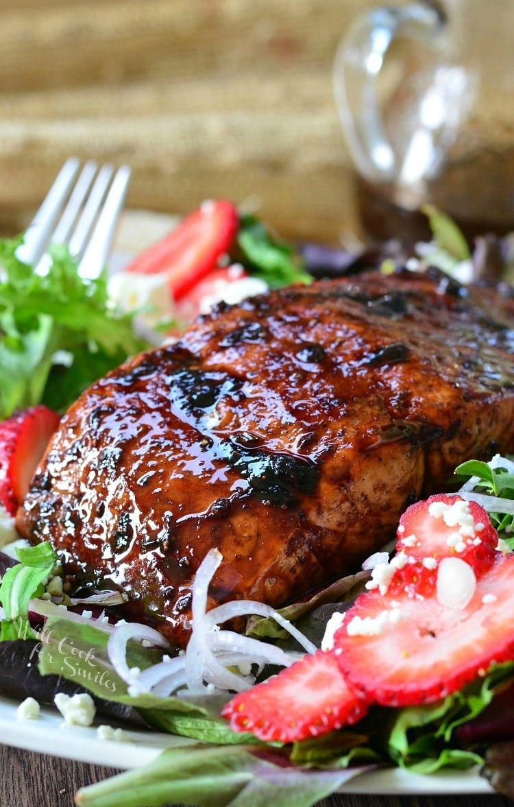 Strawberry Balsamic salad with Glazed Salmon over the top of it