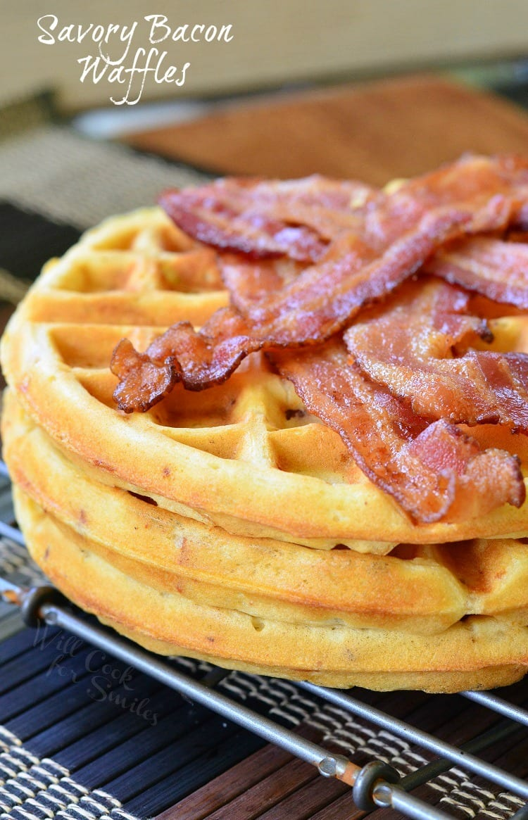 Savory Bacon and Onion Waffles with bacon slices on top on a cooking rack