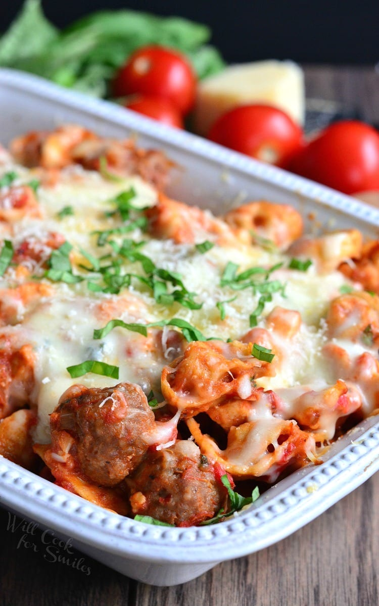 Chicken and Sausage Parmesan Tortellini Casserole in a white casserole dish