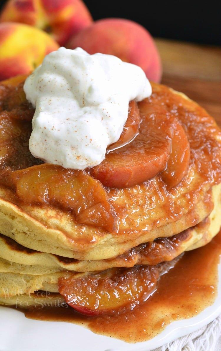 Peaches and Cream Fluffy Buttermilk Pancakes. Soft, heavenly buttermilk pancakes slathered with freshly made cinnamon peach topping and cinnamon whipped cream.
