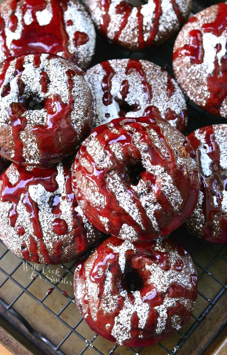 Raspberry Chocolate Doughnuts. Soft, baked chocolate doughnuts that are filled with fresh raspberry jam, sprinkled with powder sugar and drizzle with more raspberry sauce.