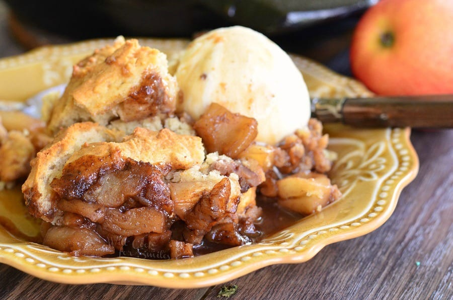 Maple Pecan Apple Cobbler Skillet with a scoop of vanilla ice cream on a yellow plate