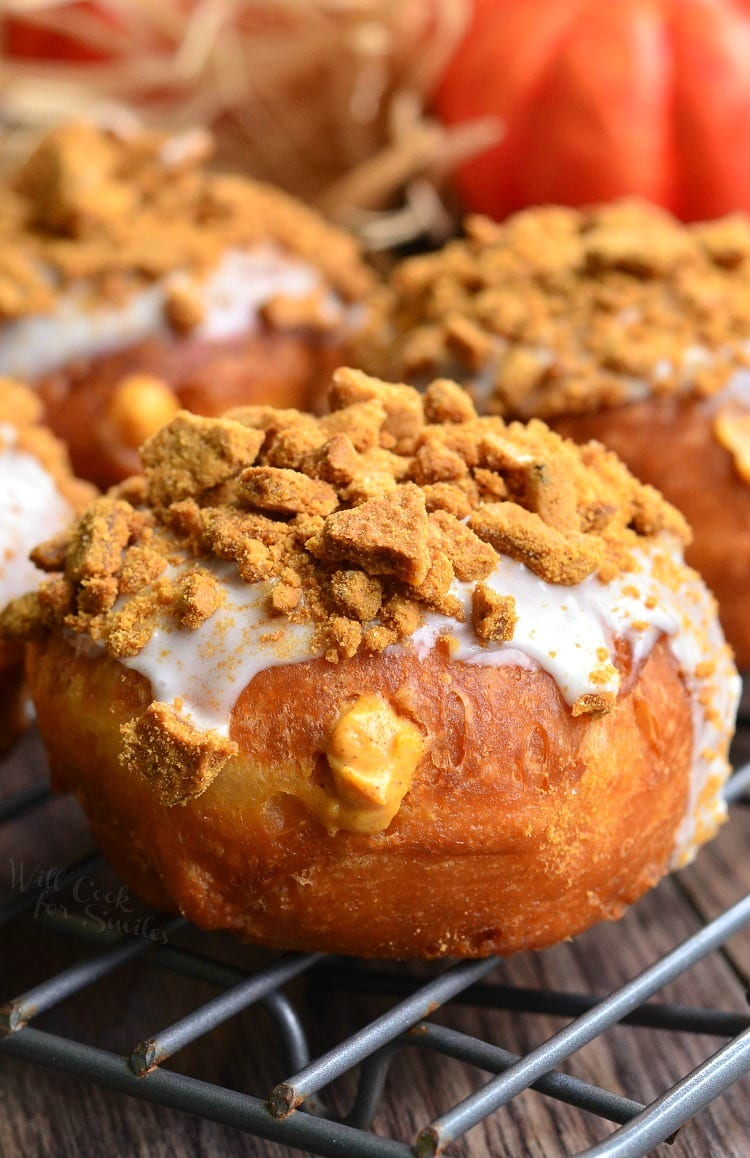 Pumpkin Cheesecake Doughnuts with Gingersnap Crumb. Easy stuffed doughnuts filled with pumpkin cheesecake mixture and topped with pumpkin spice icing and crispy gingersnap cookies