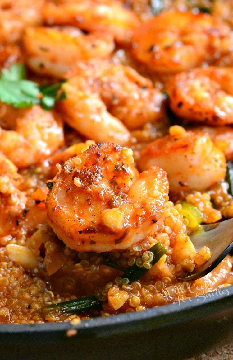 One Pot Cajun Shrimp and Quinoa. Spicy seafood dinner that's easily made in about 30 minutes. Spicy Cajun shrimp over tasty quinoa cooked in citrus Cajun broth.