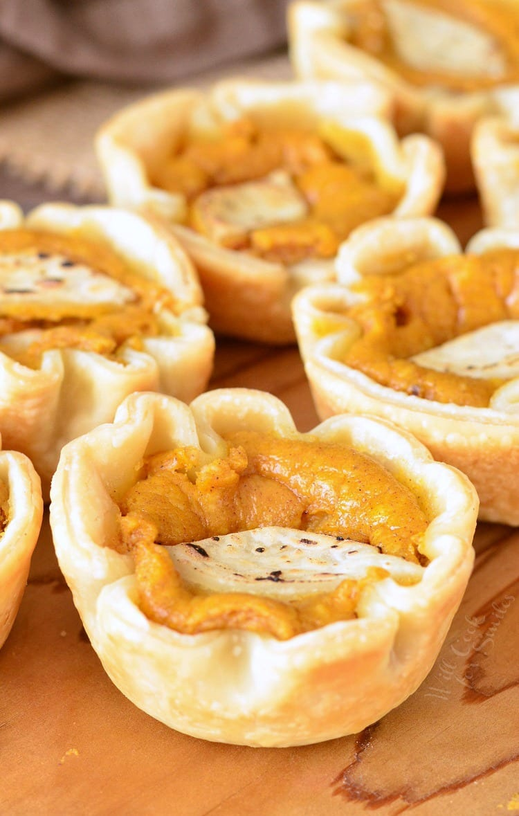 Mini Pumpkin Cheesecake Pies. Little individual pies filled with soft pumpkin pie cheesecake filling.