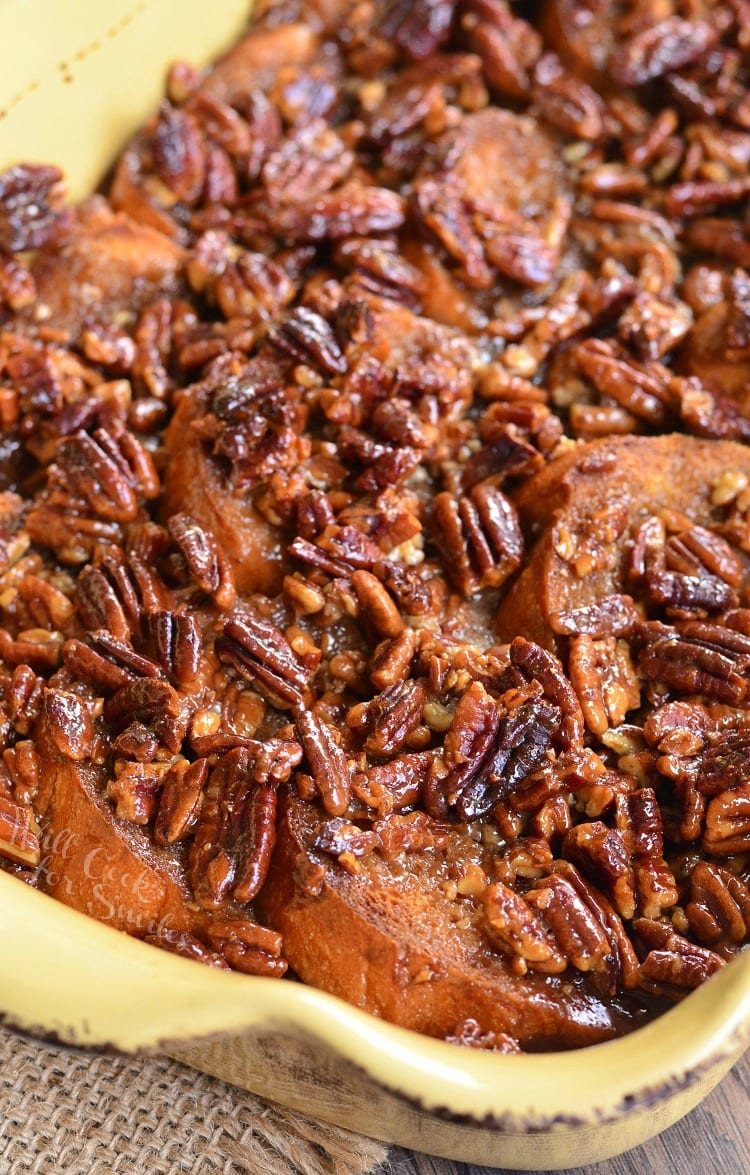 Pecan Pie French Toast Casserole in a yellow casserole pan