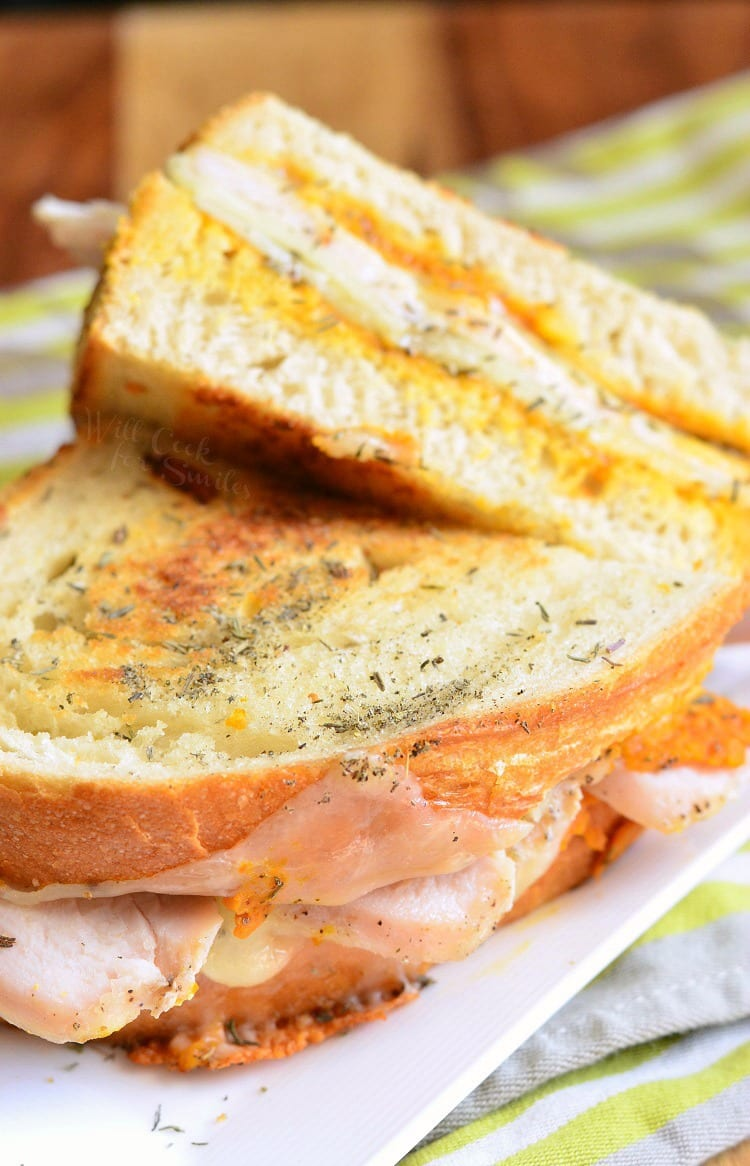 Pumpkin Turkey and Herb Grilled Cheese on a white plate