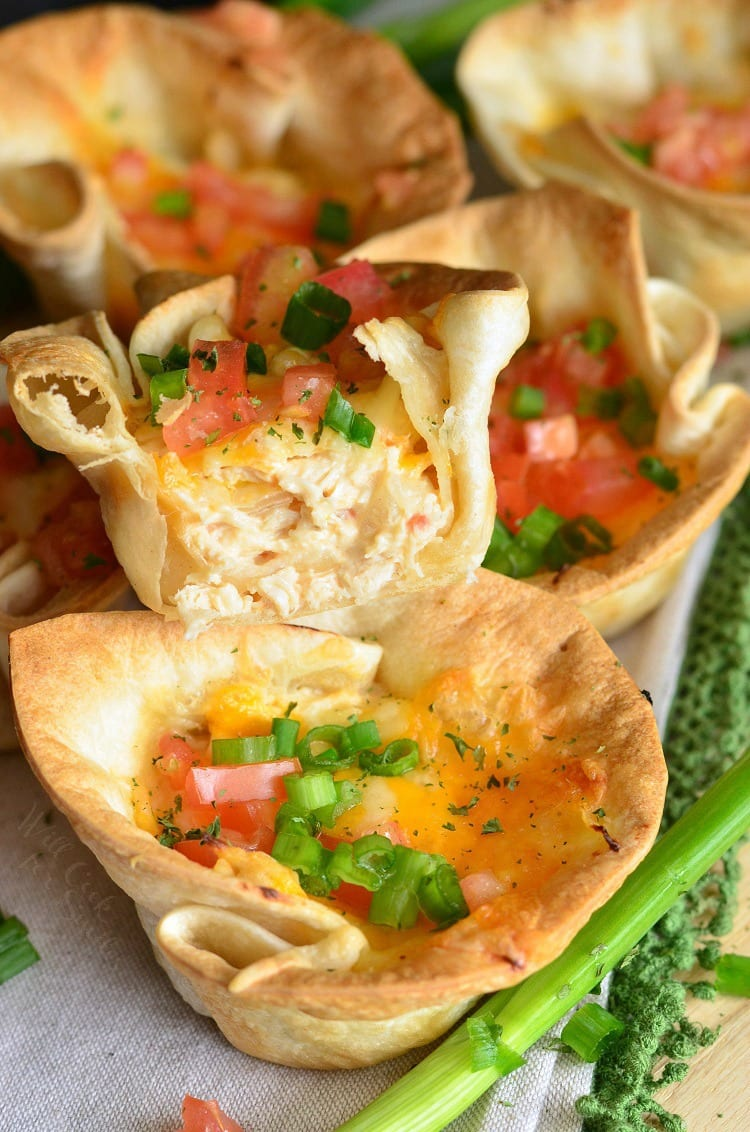 Creamy Chicken Enchilada Tortilla Cups. Heavenly crispy tortilla cups filled with creamy chicken enchilada mixture and more cheese.