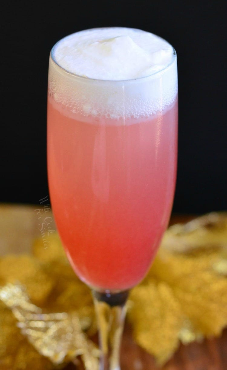 Close up of Raspberry Italian Soda Champagne Cocktail in a champagne flute