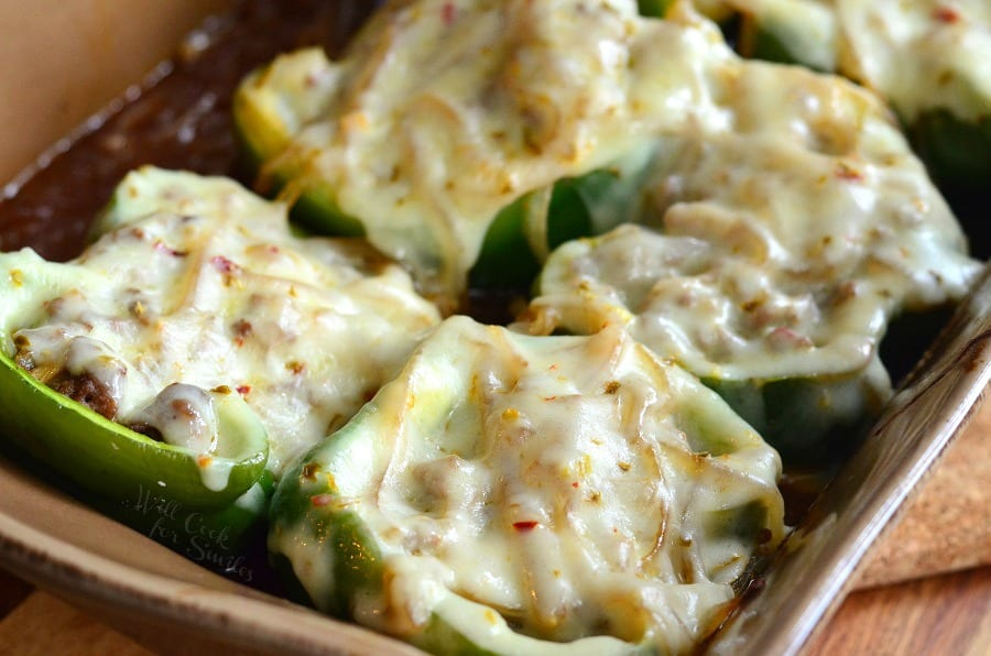 Salisbury Steak Stuffed Peppers with cheese on top in a brown casserole dish