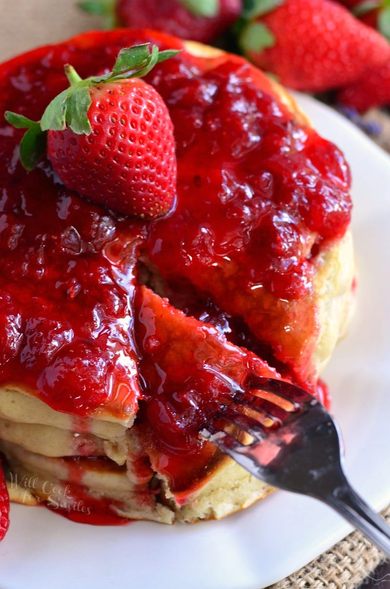 These homemade pancakes are made with fresh strawberries and lavender inside and topped with a freshly made strawberry lavender topping.