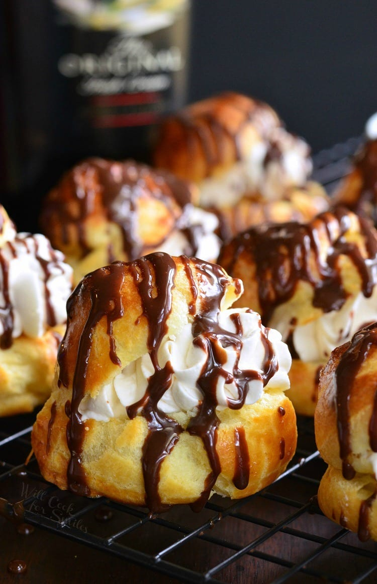 Baileys Cream Puffs. These little treats are made of fresh choux pastry, filled with Baileys whipped cream, and topped with easy Baileys chocolate sauce.