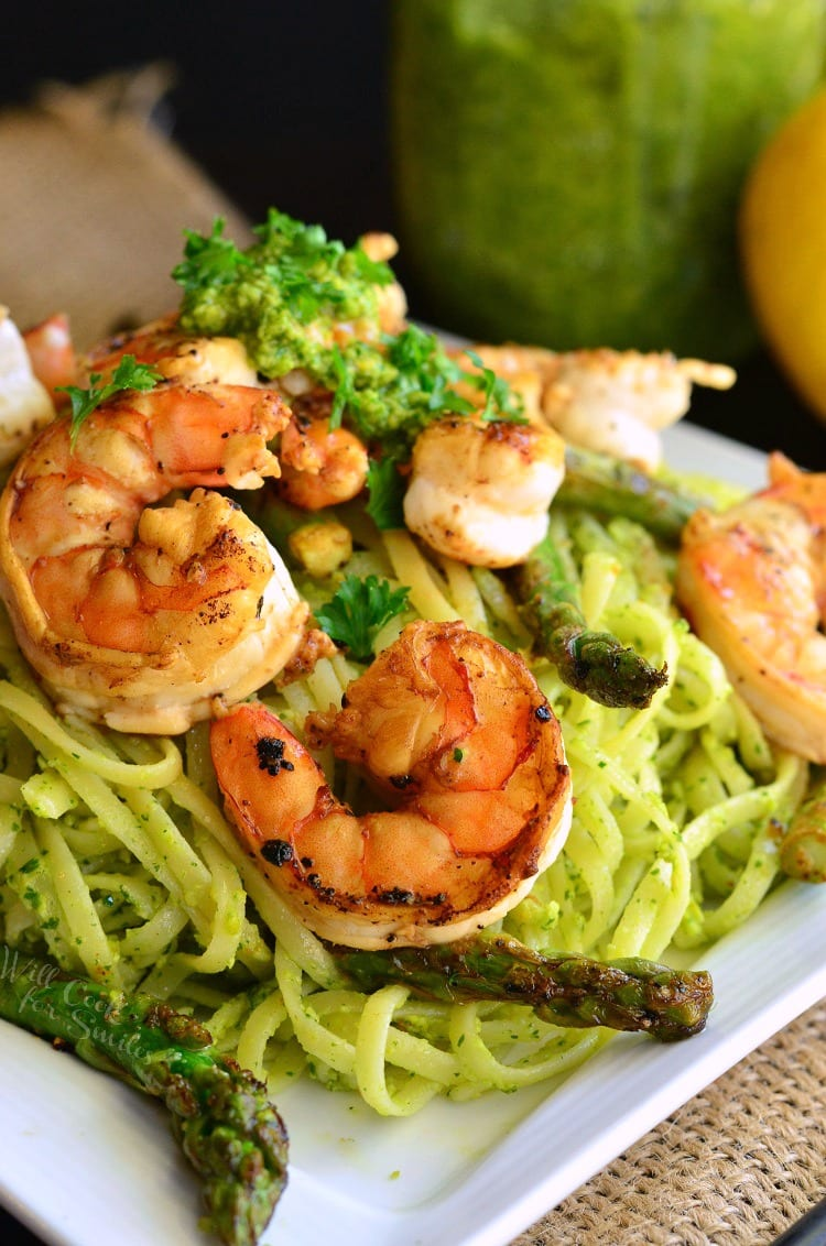 Lemon Pistachio Pesto Pasta with Shrimp and Asparagus. Delicious twist on a pesto pasta dish flavored with homemade Lemon Pistachio Pesto and served with sauteed asparagus and shrimp.
