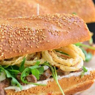 Onion Rings, Arugula, and Blue Cheese Steak Sandwich