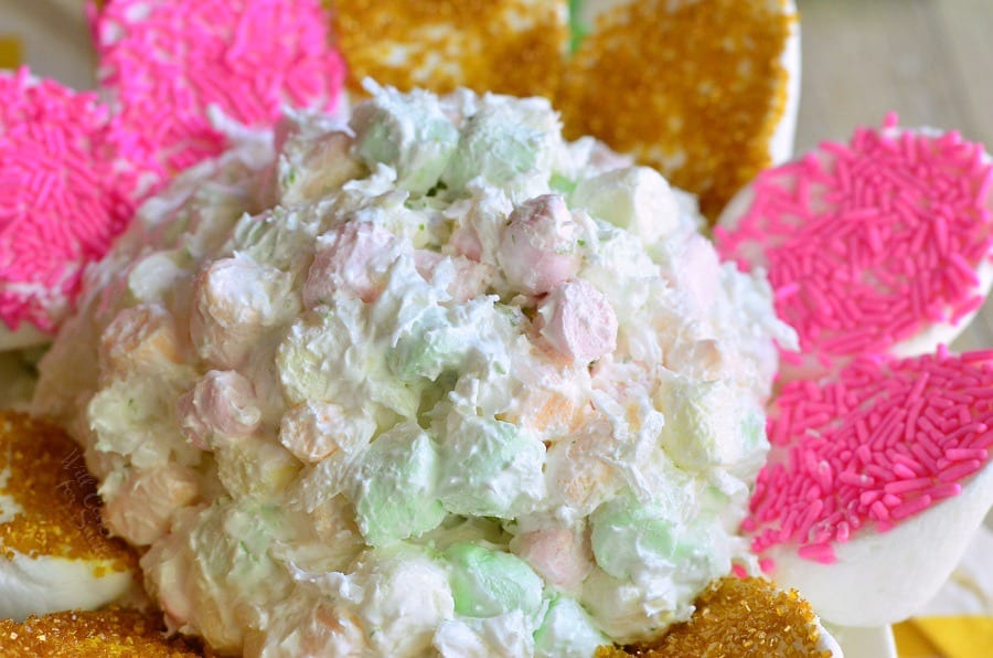 Coconut Key Lime Marshmallow Dip with pink and gold marshmallows around it