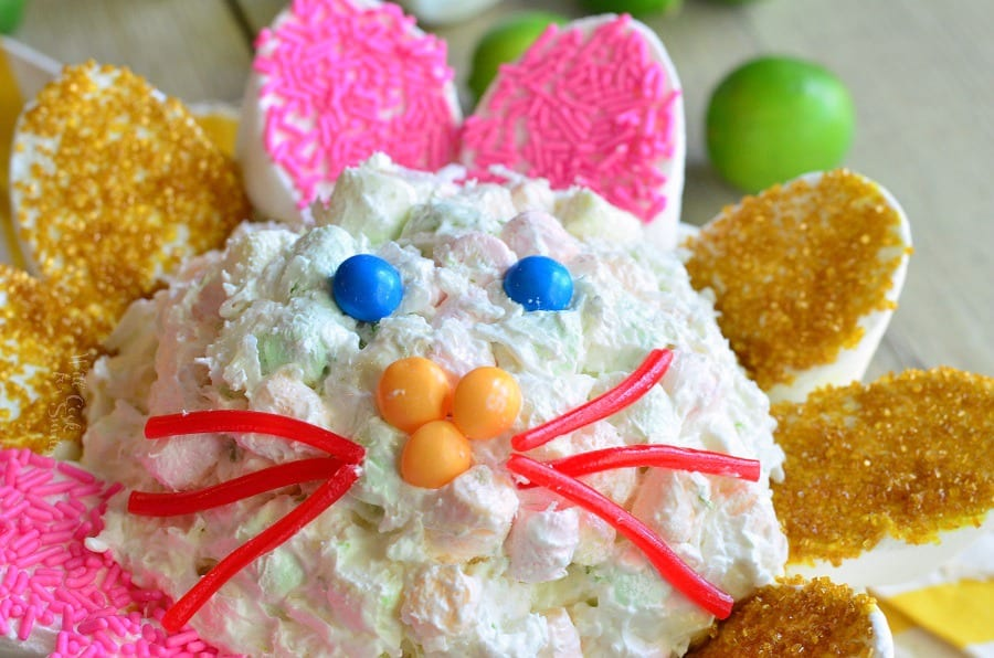 Coconut Key Lime Marshmallow Dip made into a bunny with red lickerish as whiskers and yellow skittles as a nose and blue skittles as eyes