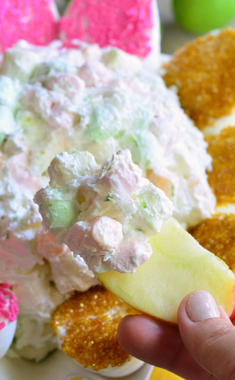 dipping apple in Coconut Key Lime Marshmallow Dip