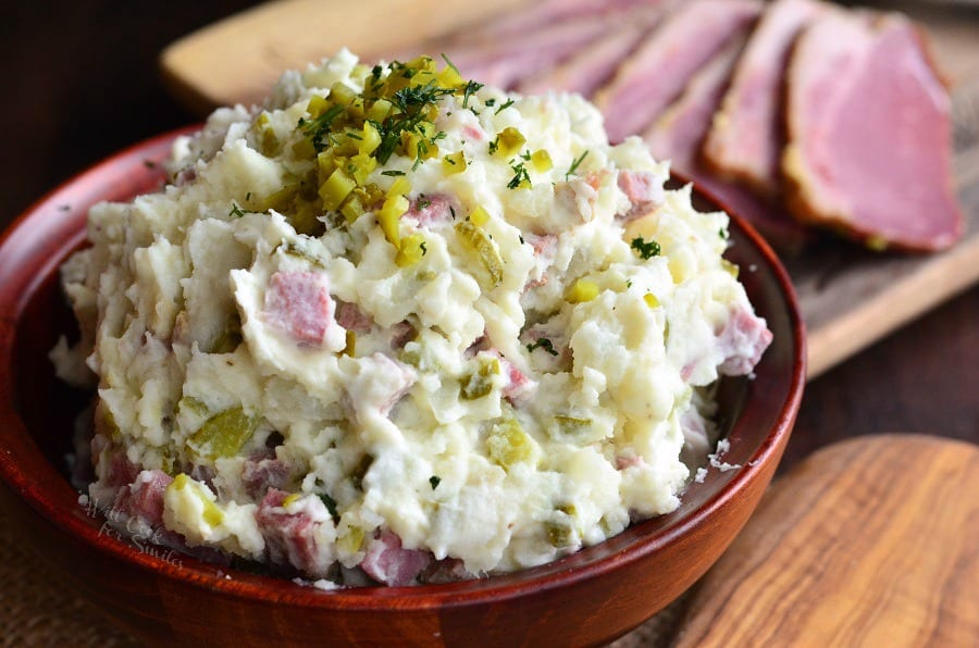 Corned Beef Potato Salad in a wood bowl with relish on top