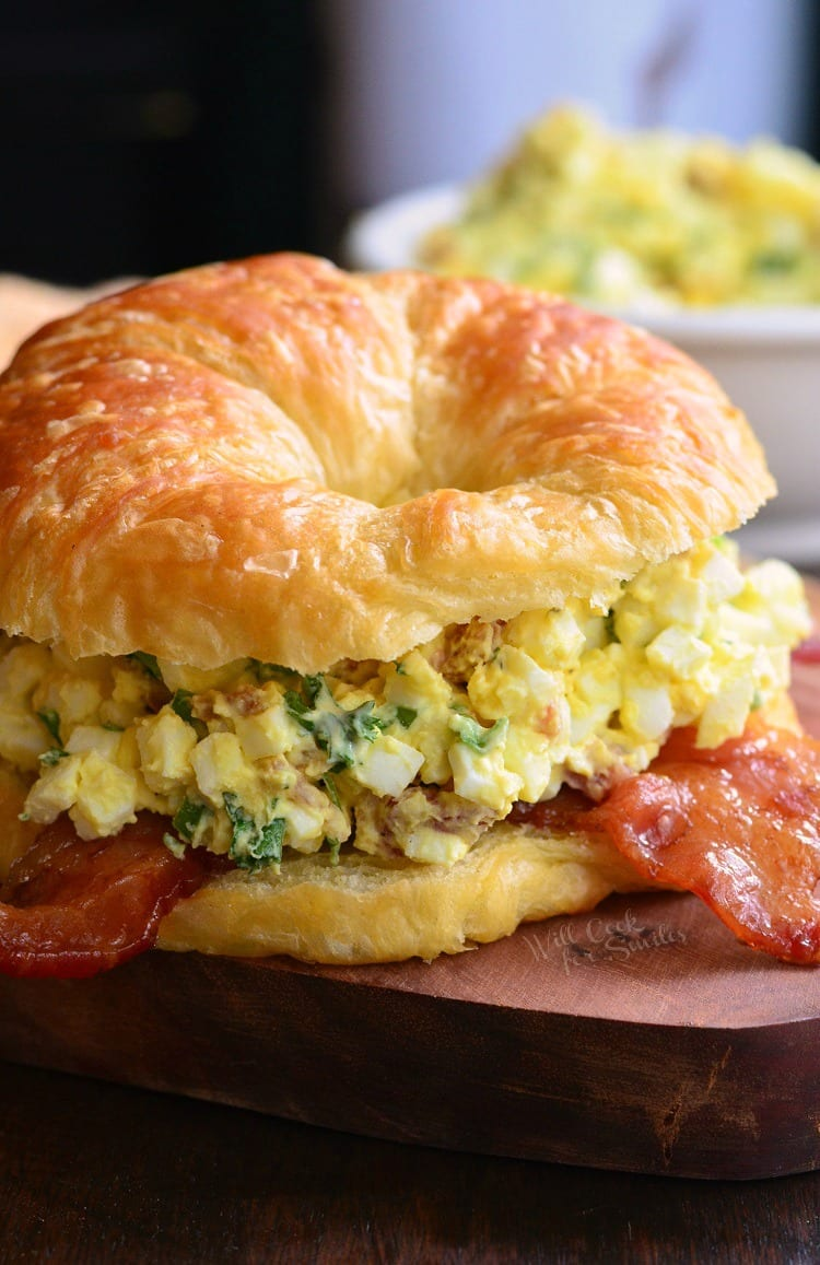 Bacon and Green Onion Egg Salad Sandwich. Combining egg salad, bacon, green onions, herbs, on a buttery, flaky croissant is a fabulous way to dress up all those leftover hard boiled eggs.