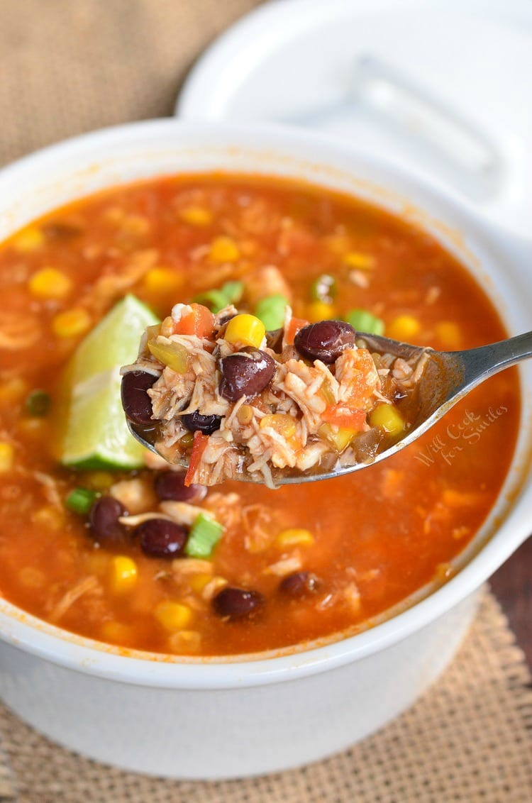 Chicken Tortilla Soup. This homemade chicken soup is made from scratch, with tomato base, shredded chicken, veggies, and a spice kick.