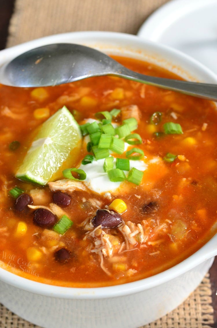 Chicken Tortilla Soup Recipe. This homemade chicken soup is made from scratch, with tomato base, shredded chicken, veggies, and a spice kick.