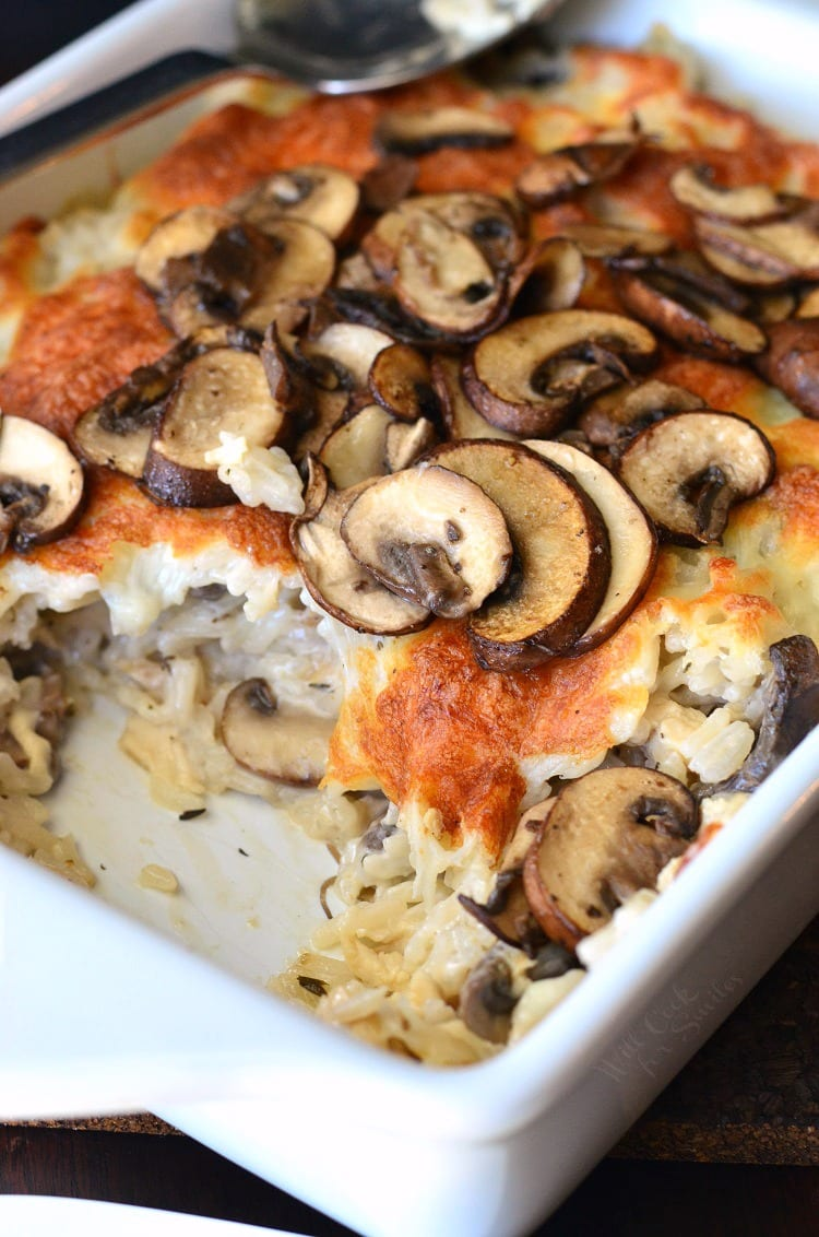 Creamy Chicken Mushroom Rice Casserole in a white baking dish