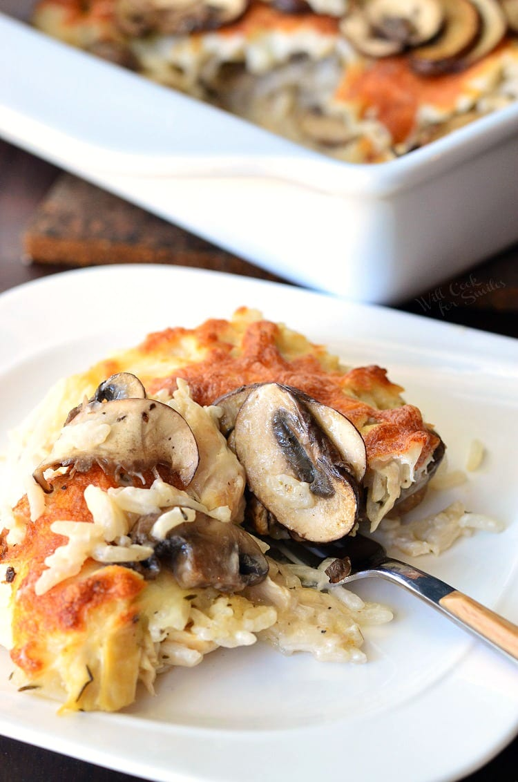 Creamy Chicken Mushroom Rice Casserole on a plate with a fork