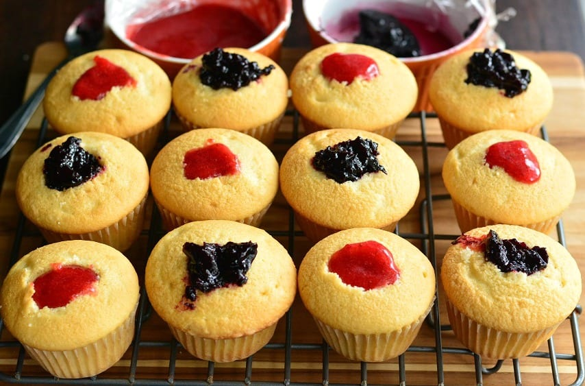 Berry Filled Cupcakes with Strawberry and Blueberry Marble Frosting. from willcookforsmiles.com