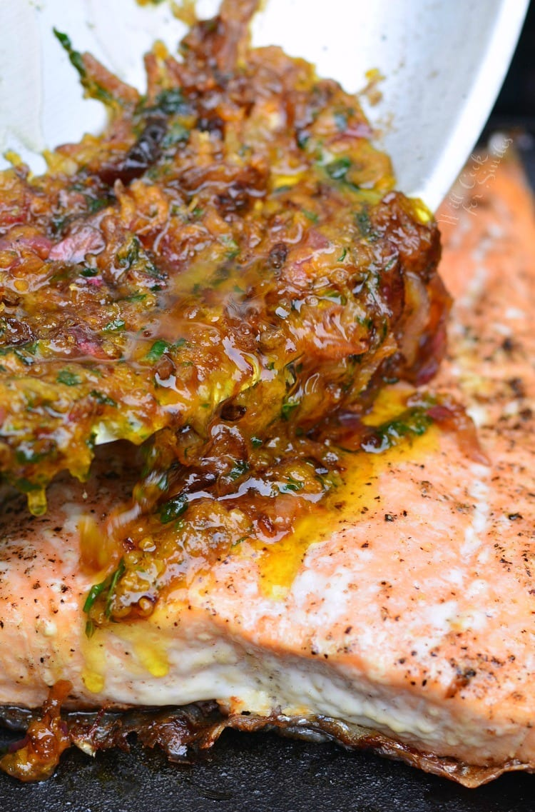 Pouring Brown Butter Citrus Sauce over salmon