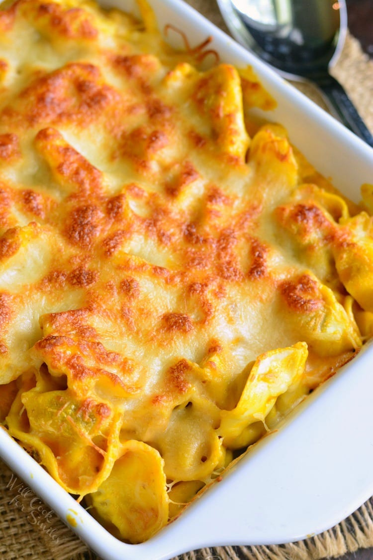 Spicy Three Cheese Pumpkin Tortellini Bake in a white casserole dish