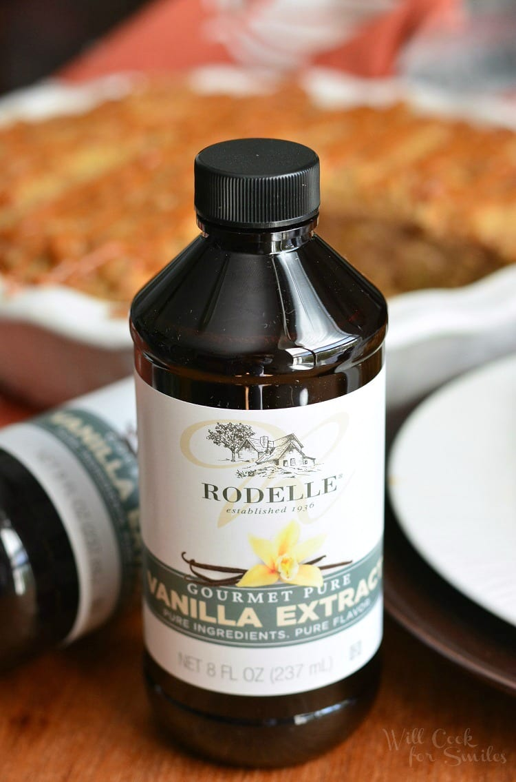 a bottle of Rodelle vanilla extract with the pie in the background