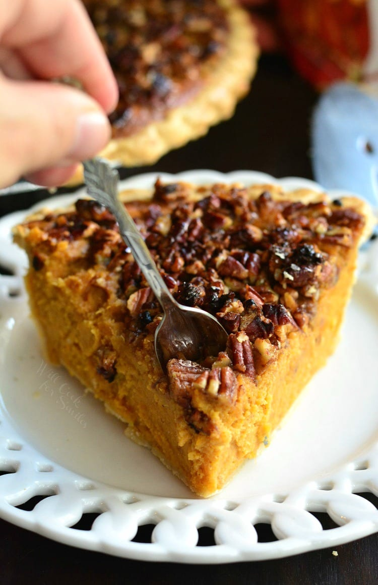 Pecan Crunch Sweet Potato Pie on a plate with me putting the fork in it
