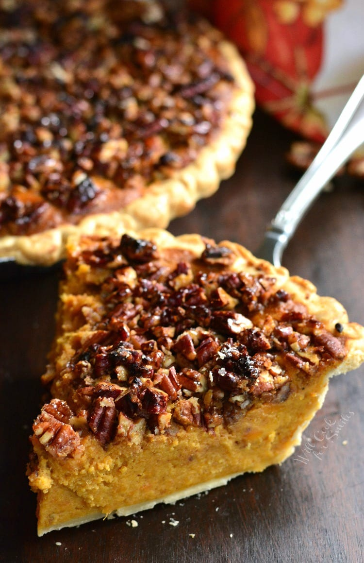 Pecan Crunch Sweet Potato Pie piece on a table with a pie spatula and the rest of the pie in the background